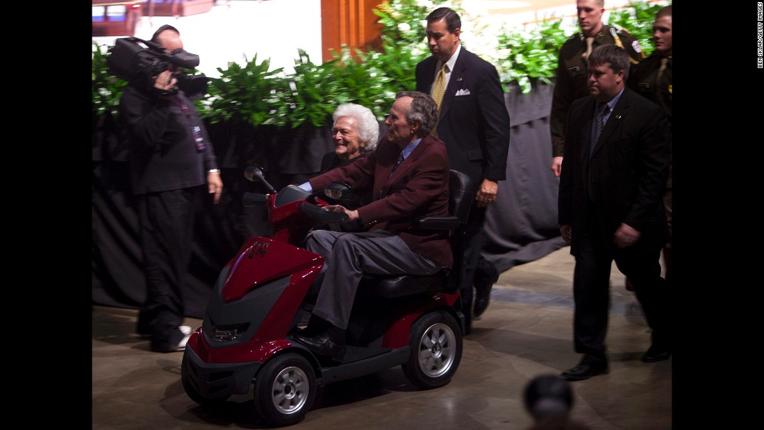 The former President and first lady leave after a panel discussion at an event commemorating the Gulf War on January 20, 2011.