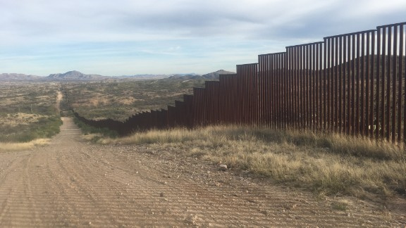 """There are about 700 miles of fence along the 1,933-mile international US-Mexico boundary. This stretch in Sasabe, Arizona, has a fence that was built in 2007. """"I think a barrier, a physical barrier, is definitely necessary,"""" Shawn Moran, vice president of The National Border Patrol Council, told CNN. """"Putting up a fence, putting up a wall, has stopped the vehicle loads from coming across the border.  It has been almost 100% effective in doing that."""""""