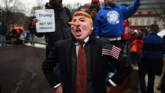 Demonstrators protest against US President-elect Donald Trump before his inauguration on January 20, 2017, in Washington, DC.