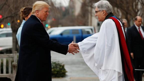 The Rev. Luis Leon greets the Trumps on their arrival for the service at St. John