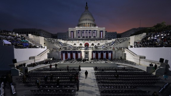 The sun begins to rise behind the Capitol as Washington prepares for Donald Trump