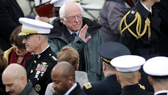 Sen. Bernie Sanders waves to the crowd from the West Front of the Capitol before the ceremony.