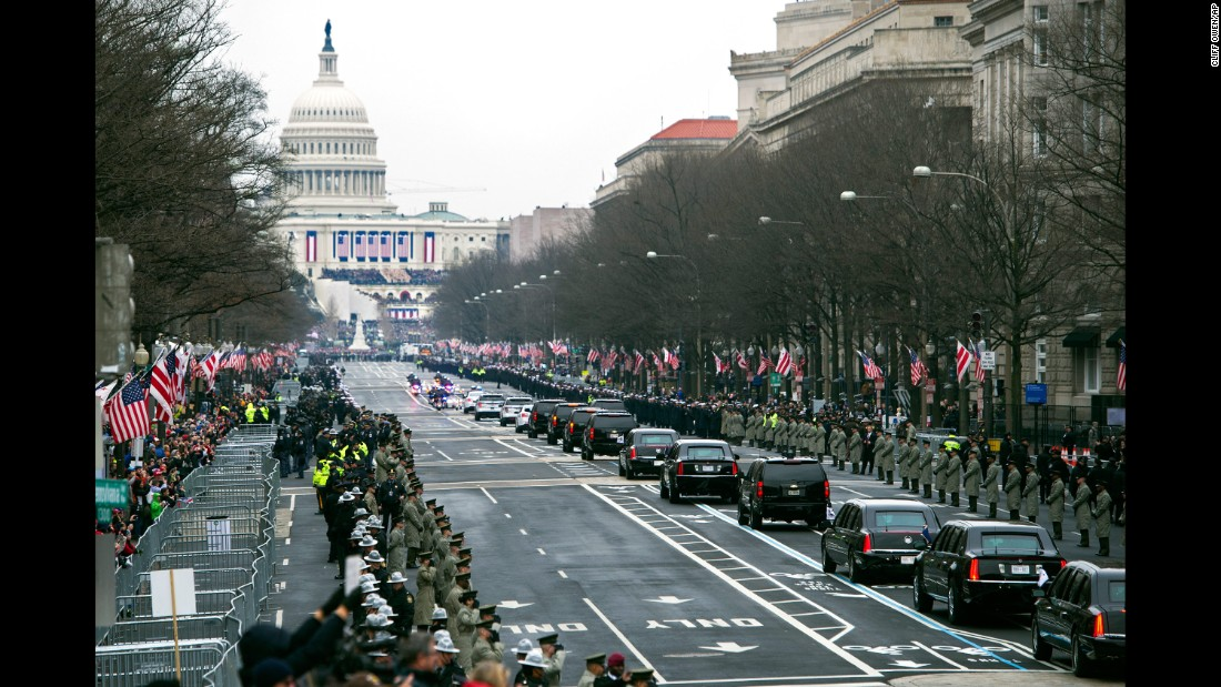 The presidential motorcade moves down Pennsylvania Avenue to the Capitol for the inauguration ceremony.
