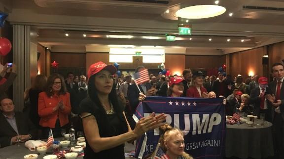 People watch US President Donald Trump