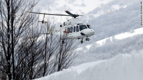 A rescue helicopter approaches the avalanche area in Rigopiano, central Italy, Friday.