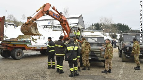 Italian rescuers prepare to join the operation near the village of Penne on Friday.