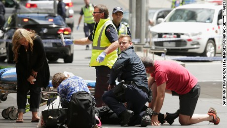 Members of the public receive medical treatment after a car driven by James Gargasoulas crashed into crowds in Melbourne, Australia, January 20, 2017.