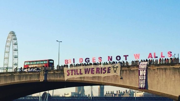 """Protesters hold letters spelling out """"Bridges Not Walls"""" on London"""