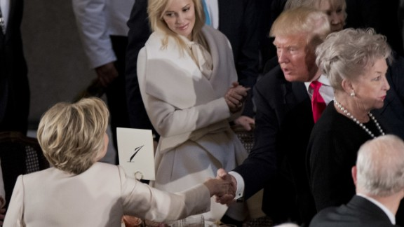 Newly sworn in President Trump shakes hands with Hillary Clinton.
