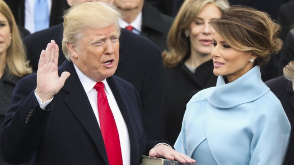 Donald Trump is sworn in as the 45th President of the United States as his wife, Melania, looks on during the inauguration ceremony in Washington on Friday, January 20. He used a family bible and one that belonged to Abraham Lincoln.