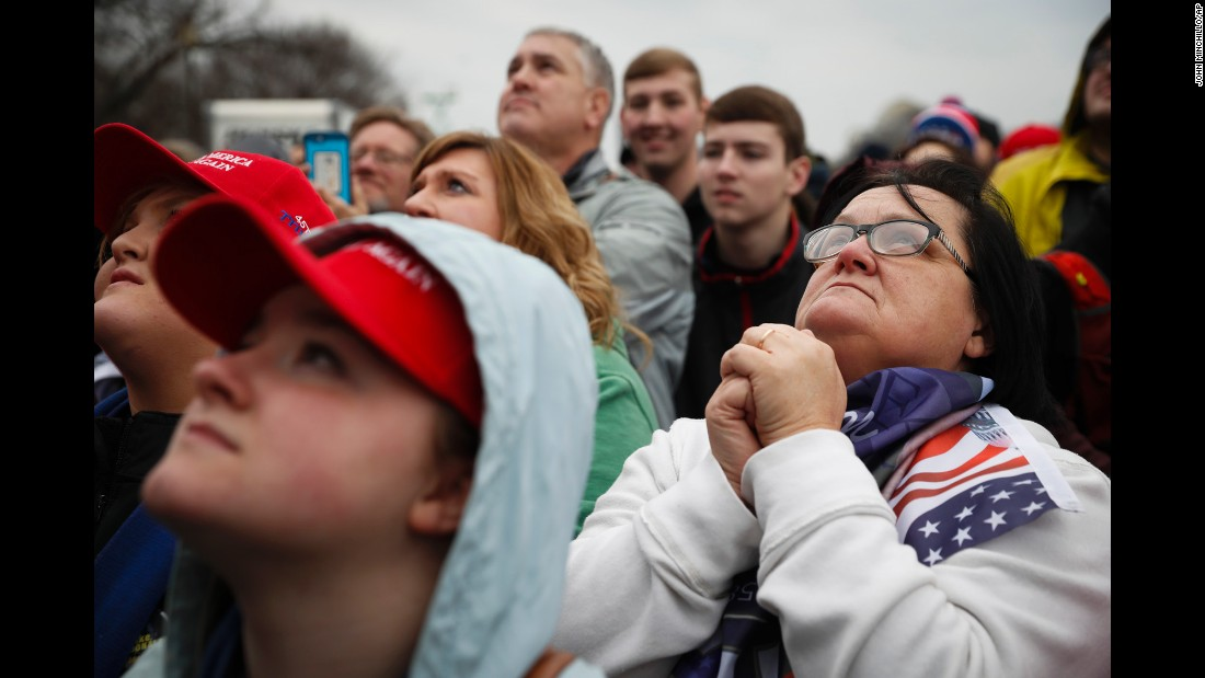 Trump supporters listen during the inauguration in Washington on Friday, January 20.