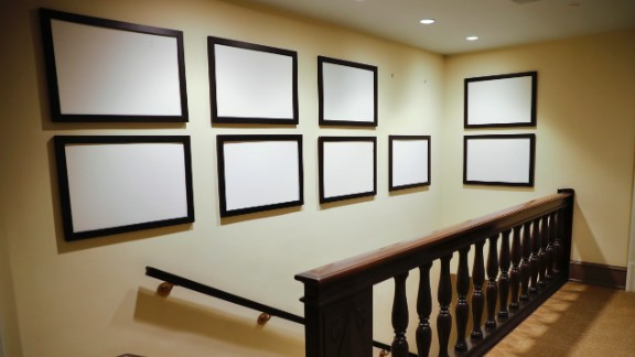 Photos of Barack Obama and his family, which lined walls in the West Wing of the White House, are removed on Thursday, January 19. Obama's presidency came to an end the following day, when Donald Trump was sworn in as the 45th president. The Obamas are moving to a house in Washington's Kalorama neighborhood.