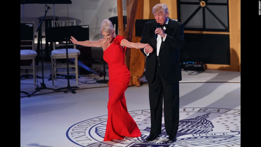 Donald Trump holds the hand of Kellyanne Conway, his senior adviser, as she takes a bow during a VIP reception and dinner with donors in Washington on Thursday, January 19, the night before Trump's presidential inauguration.