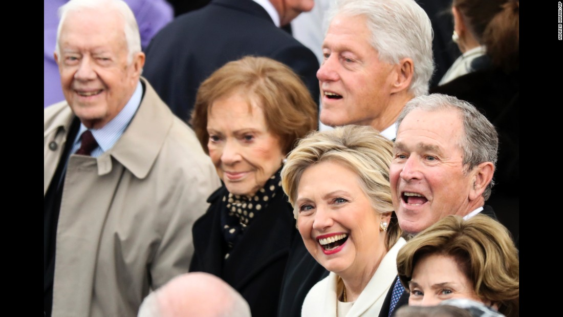 Hillary Clinton, who was the 2016 Democratic presidential nominee, smiles before the start of Donald Trump's presidential inauguration in Washington on Friday, January 20. Around her are former President Bill Clinton, former President Jimmy Carter and his wife, Rosalynn, as well as former President George W. Bush and his wife, Laura.