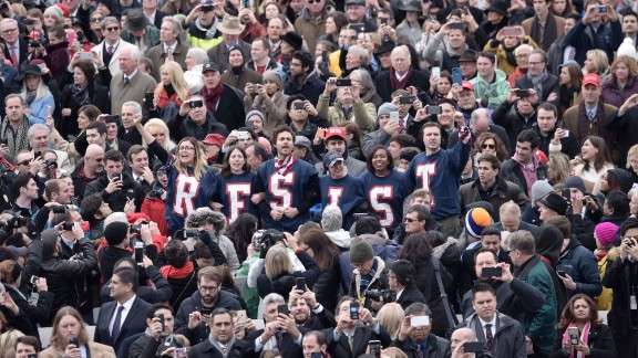 """Members of the public chant slogans and display T-shirts reading """"resist"""" during a protest at the beginning of Donald Trump's swearing-in ceremony as 45th President."""