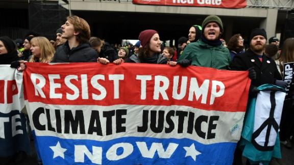 Demonstrators shout slogans against Trump.