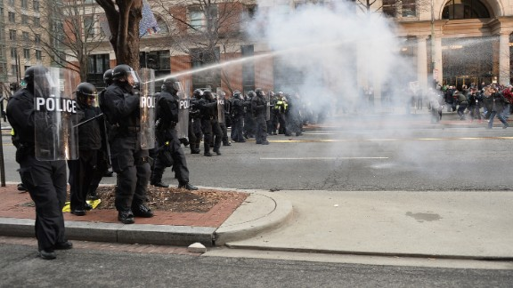 """Protesters clash with police. """"I think Donald Trump is a fascist, and it's very easy for people, especially people who are in pain, to slip into fascism,"""" said protester Lysander Reid-Powell, a 20-year-old student from New Mexico."""