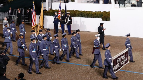 President Donald Trump salutes members of the New York Military Academy during the 58th Presidential Inaugural Parade on Friday, January 20.