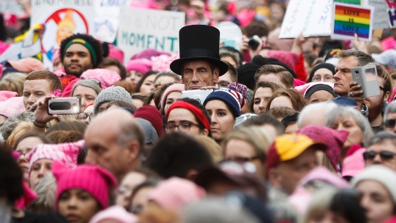 A man dressed as Abraham Lincoln stands with protesters.