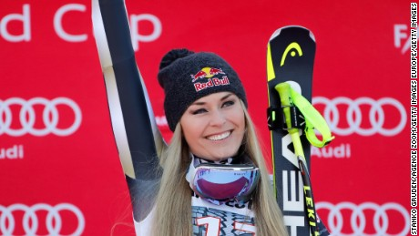 Lindsey Vonn celebrates on the podium after winning the FIS Alpine Ski World Cup Downhill in Garmisch-Partenkirchen.