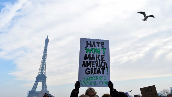 Protesters hold up anti-Trump signs as more than 2,000 people protest during the Women