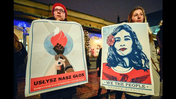 People gather outside the US Consulate in Krakow, Poland during the Women