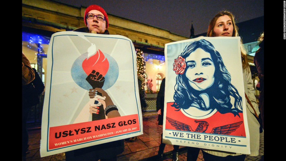 People gather outside the US Consulate in Krakow, Poland during the Women's March on Washington on January, 21 2017.