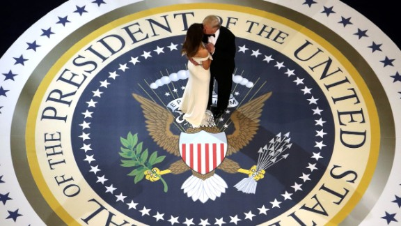 Trump kisses the first lady as they dance at one of three inaugural balls on January 20. The former real estate mogul, known for his affinity of over-the-top gold fixtures, went for classic Americana with a touch of retro glitz.