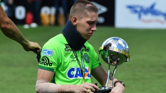 Brazilian Chapecoense goalkeeper Jackson Follmann, a survivor of the LaMia airplane crash in Colombia, holds the Copa Sudamericana trophy at the Arena Conda stadium in Chapeco, Santa Catarina state, in southern Brazil on January 21, 2017, before a friendly match against Palmeiras - Brazilian Champion 2016.  Most of the members of the Chapocoense football team perished in a November 28, 2016 plane crash in Colombia. / AFP / NELSON ALMEIDA        (Photo credit should read NELSON ALMEIDA/AFP/Getty Images)