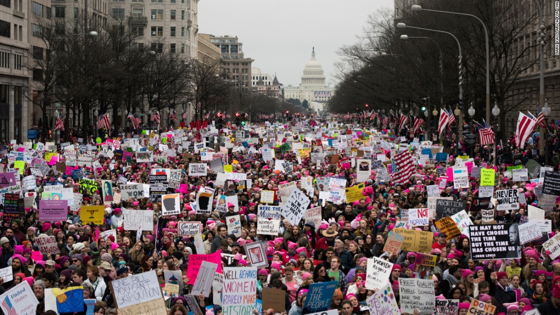 "A large crowd walks down Pennsylvania Avenue after the start of the Women's March on Washington on Saturday, January 21, 2017. Organizers said the march is sending a message to Donald Trump that ""women's rights are human rights."" Similar protests unfolded across the country."