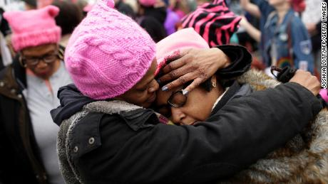 A mother embraces her daughter during the Women's March on January 21, 2017, in Washington, DC.