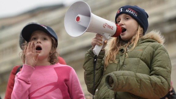 Young protesters shout on the National Mall in Washington, DC, for the Women