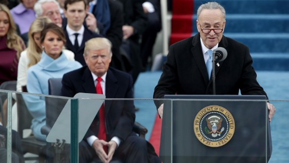 Sen. Chuck Schumer delivers remarks as President-Elect Donald Trump looks on on the West Front of the U.S. Capitol on January 20, 2017 in Washington, DC.