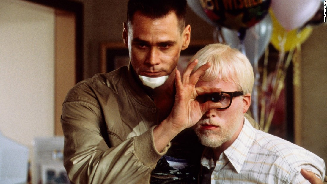 "Jim Carrey, left, and Michael Bowman in ""Me, Myself & Irene."" Carrey plays a state trooper who develops a second personality, which interferes with his duties."