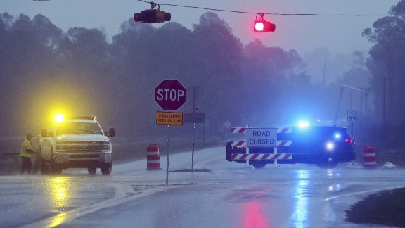 A Brooks County sheriff's deputy blocks Highway 122 near Barney as workers repair a utility pole on January 22.