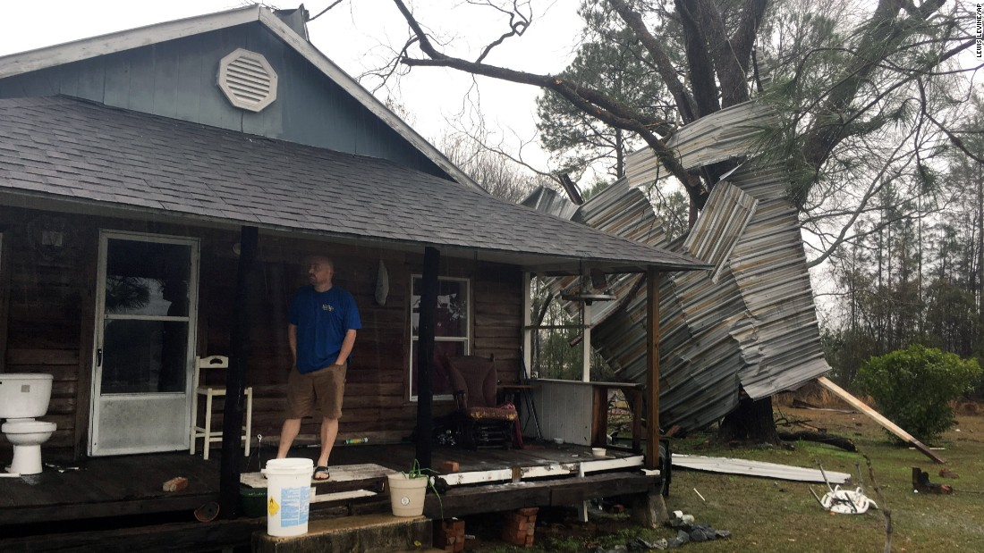 Jason Williams stands on the porch of a home belonging to his neighbor, Lamar Waters, in Appling County, Georgia, on January 22.