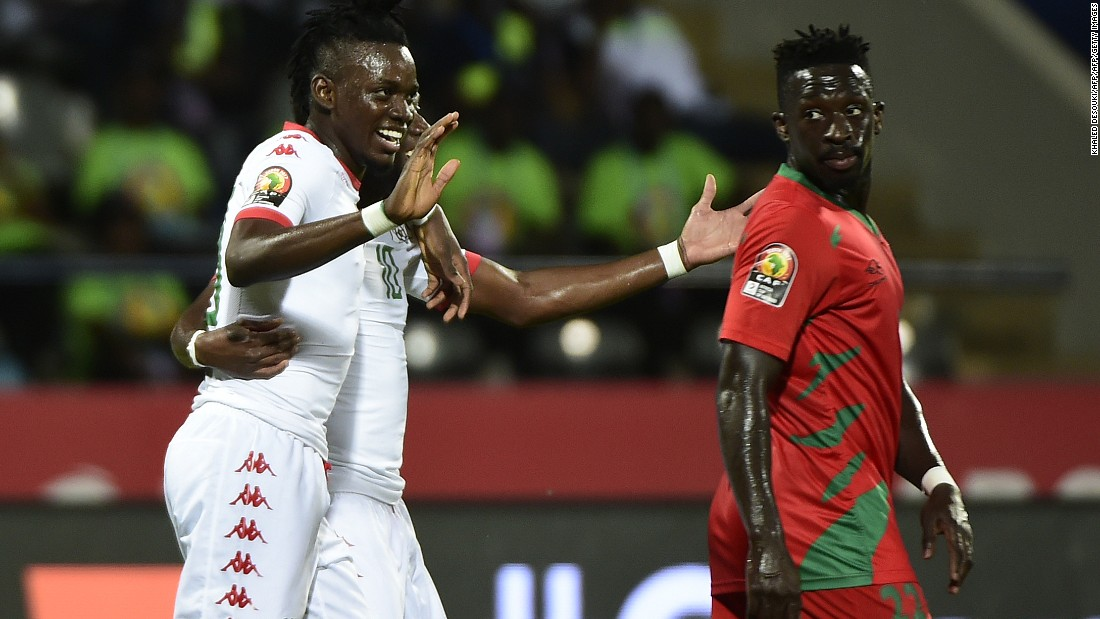 Burkina Faso's  Alain Traore and Bertrand Traore celebrate the second goal for the latter in the win over Guinea-Bissau, which left their side top of Group A.