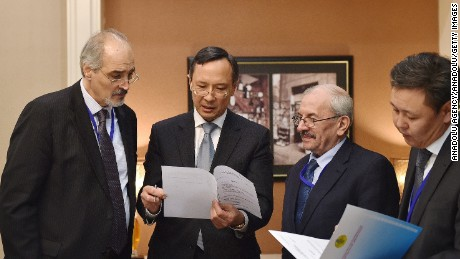 Syrian chief delegate Bashar al-Jaafari, left, with Kazakhstan Foreign Minister Kairat Abdrakhmanov, to his left, on Sunday ahead of peace talks.
