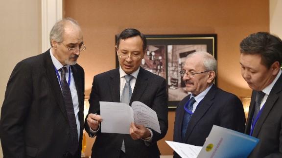 Kazakhstan Foreign Minister Kairat  Abdrakhmanov, second from left, speaks with Syrian regime representatives in Astana, Kazakhstan on Sunday.
