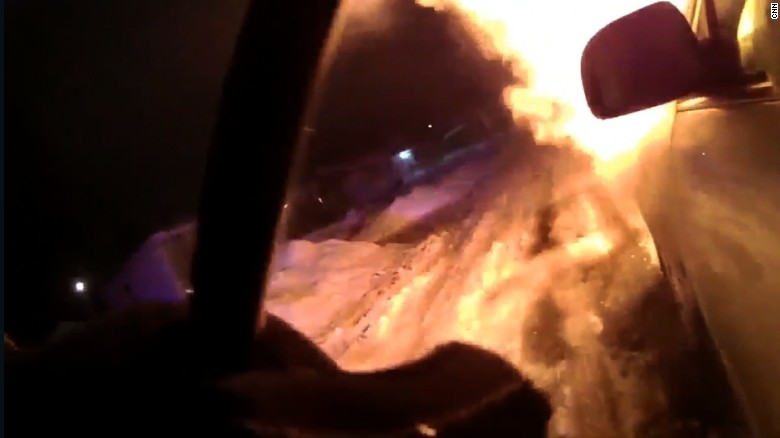 Officer saves woman from burning car