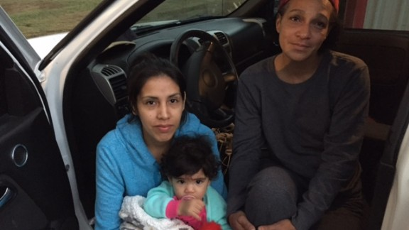 Yesenia Mondragon, left, and daughter Layla, sought shelter with Patricia McGee after the storm.