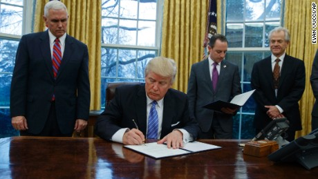 Trump signs an executive order to withdraw the US from the 12-nation Trans-Pacific Partnership trade pact.