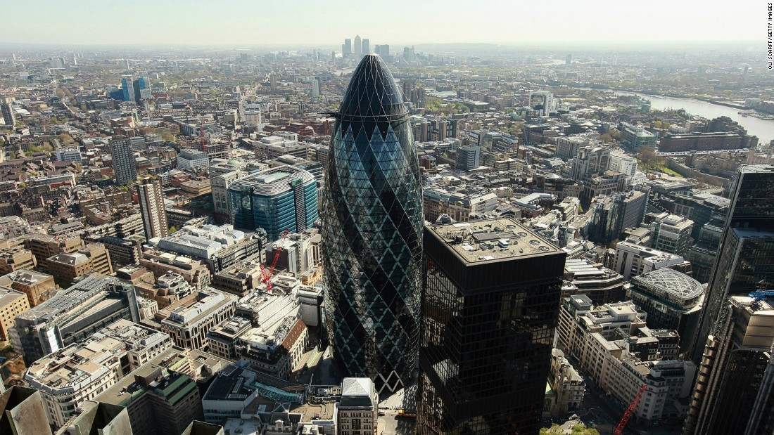 Nestled between more recent additions to the London skyline is Norman Foster's 30 St Mary Axe. Completed in 2003, it's popularly called the Gherkin (a British term for a pickled cucumber), due to its unconventional shape, designed to reduce wind deflection.<br />