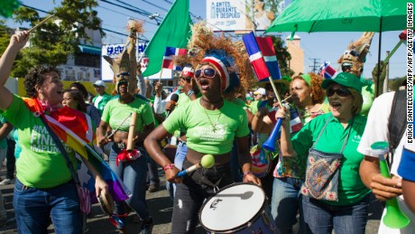 Protesters wearing green as a symbol of hope marched on the presidential palace in Santo Domingo on January 22, 2017 to demand an end to corruption. Thousands of people marched Sunday in the capital of the Dominican Republic to demand action against corruption and impunity, in a demonstration organized by more than 20 social organizations, in connection with the bribe case involving Brazilian construction giant Odebrecht and other scandals.  / AFP / afp / ERIKA SANTELICES        (Photo credit should read ERIKA SANTELICES/AFP/Getty Images)