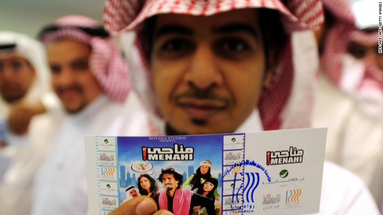 "A Saudi holds up his entrance ticket to see the Saudi comedy film ""Manahi"" at a theatre in Jeddah on December 18, 2008.  The chief of Saudi Arabia's powerful religious police said that some movies could possibly be allowed in the kingdom, despite a three-decade ban on cinemas, local press reported on December 21. The statement came in the wake of last week's breakthrough public showing of the comedy ""Manahi"" in Jeddah, which sparked hot debate in the Kingdom's religious circles but was received well among Saudi audiences.  AFP PHOTO/OMAR SALEM (Photo credit should read Omar Salem/AFP/Getty Images)"