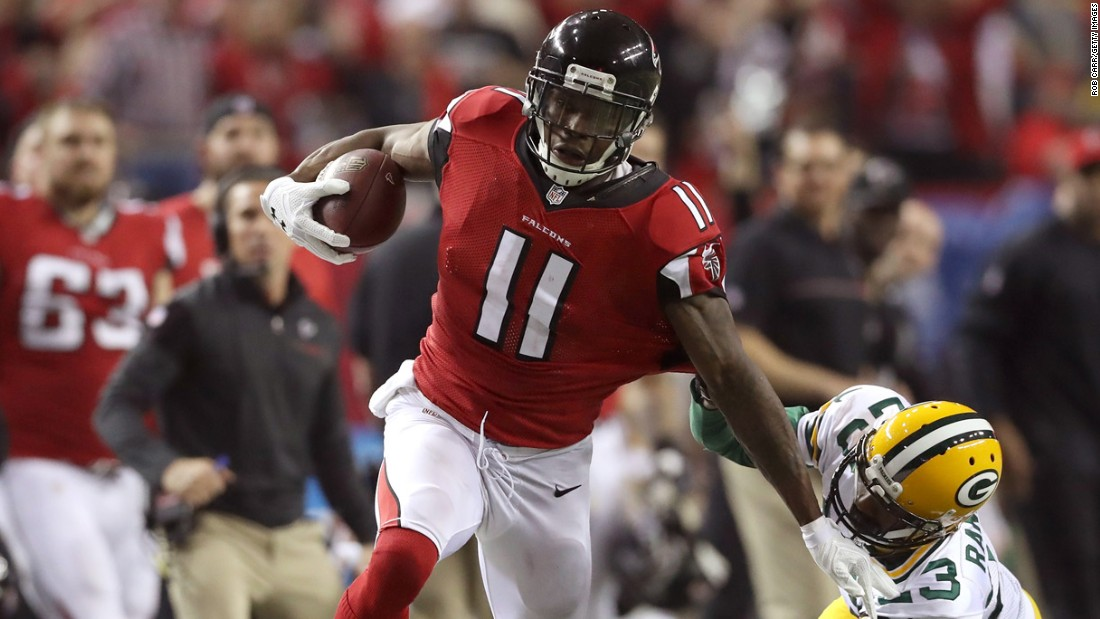 Atlanta wide receiver Julio Jones stiff-arms Damarious Randall on his way to a 73-yard touchdown on Sunday, January 22. Jones had 180 yards and two touchdowns in the Falcons' 44-21 win over Green Bay.