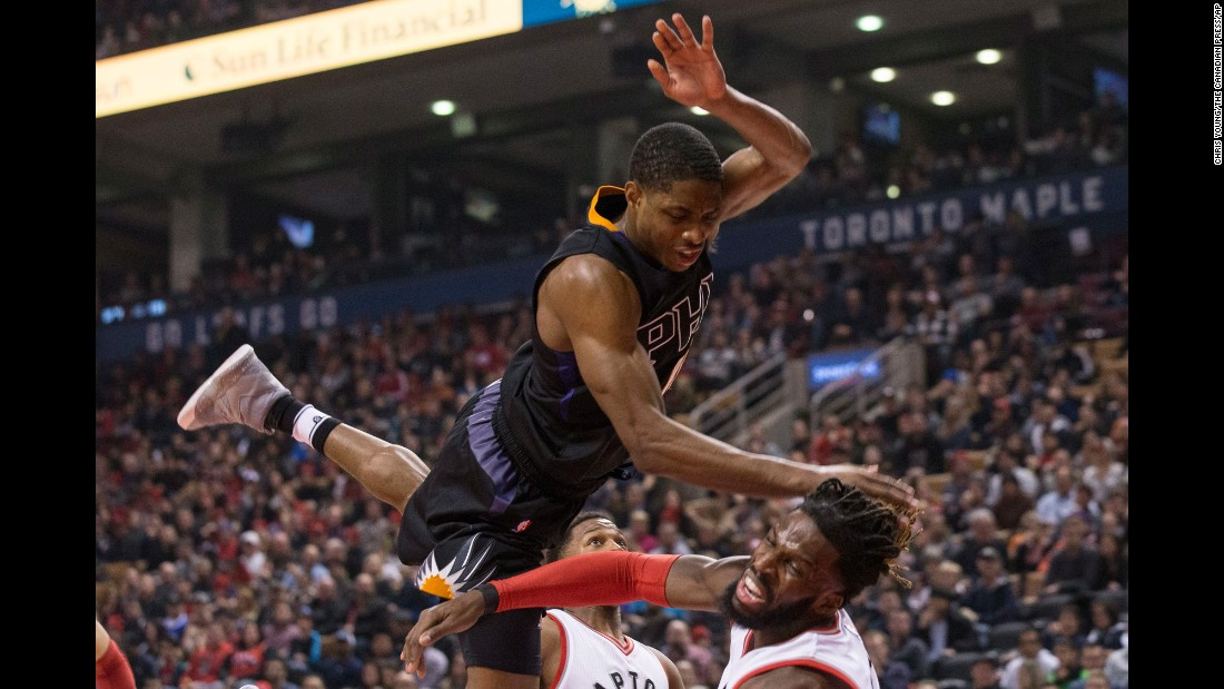 Phoenix's Brandon Knight, top, fouls Toronto's DeMarre Carroll during an NBA basketball game in Toronto on Sunday, January 22.