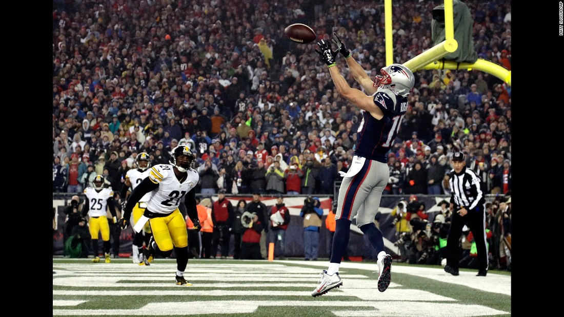 New England wide receiver Chris Hogan catches one of his two touchdown passes in the AFC Championship on Sunday, January 22. Hogan finished the game with nine catches for 180 yards.