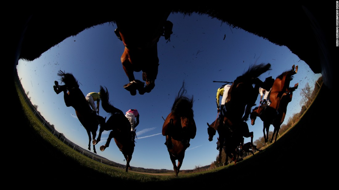 Horses jump over an obstacle during a steeplechase in Chepstow, Wales, on Friday, January 20.