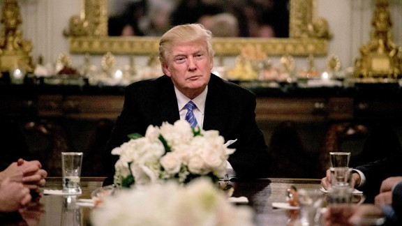 President Donald Trump looks on during a reception with Congressional leaders on January 23, 2017 at the White House in Washington, DC.